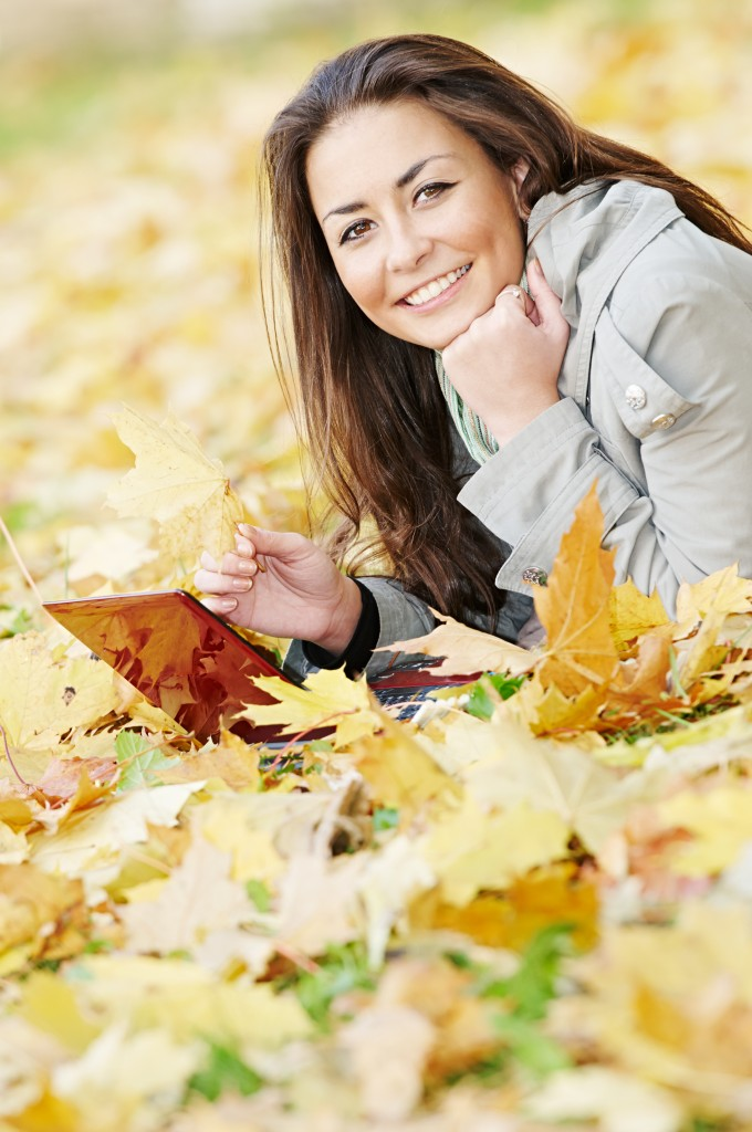 medical transcriptionist with laptop computer in autumn